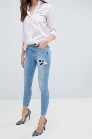 ASOS WHITBY Low Rise Skinny Jeans in Mid Wash Blue with Rip and Repair