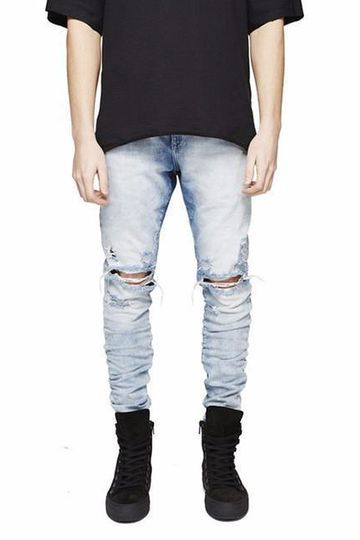 Distressed light blue washed jeans